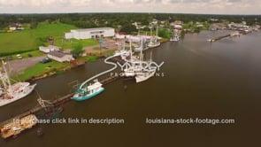 106 Delcambre Louisiana shrimp boats docked at marina orbital out