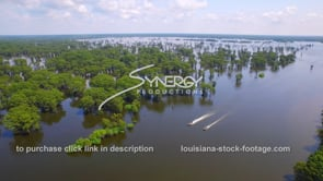 140 Awesome aerial descent in Classic Louisiana swamp with 2 swamp people boats cruising by