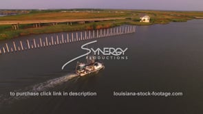 151 Nice aerial drone view of shrimp boat heading out to gulf of Mexico to catch shrimp