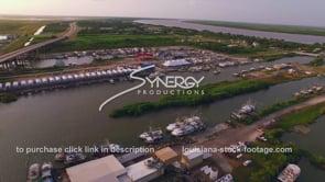 153 Nice aerial of Louisiana marina along the coast with fishing boats and shrimp boats docked