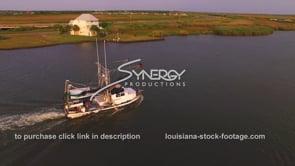 154 Nice shot shrimp boat on Louisiana coast aerial drone tracking shot