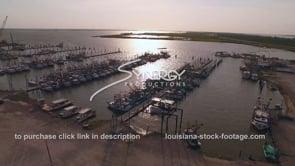 161 Louisiana shrimp boat marina aerial dolly in