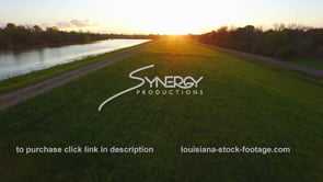 172 fast aerial drone shot along river levee during high flood stage sunset sunrise