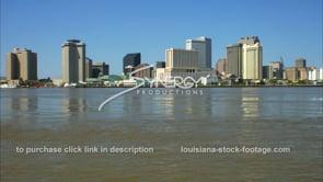 230 Tilt blue sky to new orleans downtown skyline mississippi river