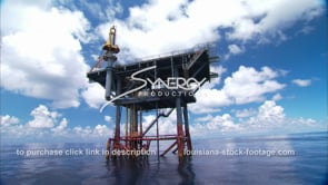 458 pan to oil gas platform on flat calm gulf of mexico