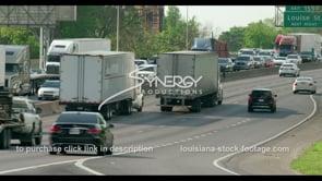 402 ambulance on Baton rouge interstate 10 rush hour traffic stock video footage