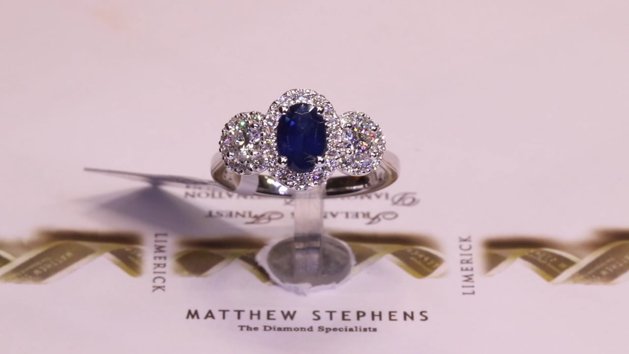 70282 - Sapphire & Diamond Three Stone Halo, S1.04ct, D0.73ct, Set in Platinum
