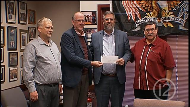 Tucson Homeless Work Program Receives Check