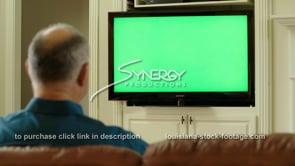 1839 man shakes head no while watching tv green screen