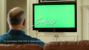 1840 man watching tv green screen replacement