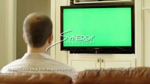 1841 millennial nods head yes watching tv green screen