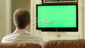 1843 young millennial watching tv green screen