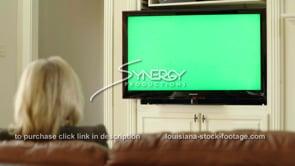 1845 woman watching tv green screen replacement