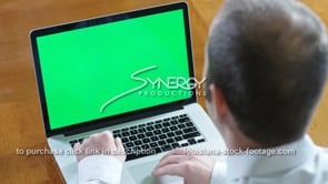 1848 young business man on laptop green screen