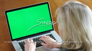 1851 business lady types on laptop green screen