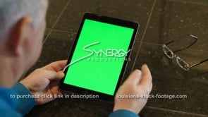 1856 man working remotely on ipad green screen