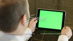 1857 man watches video on iPad green screen replacement