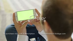 1865 watching video on smart phone green screen replacement