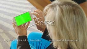 1867 woman swipes on iphone smartphone green screen