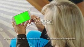 1868 woman swipes right on iphone smartphone green screen