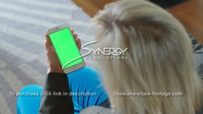 1870 woman watches iphone smartphone green screen