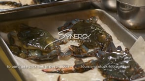 1884 chef prepping soft shell crab for cooking