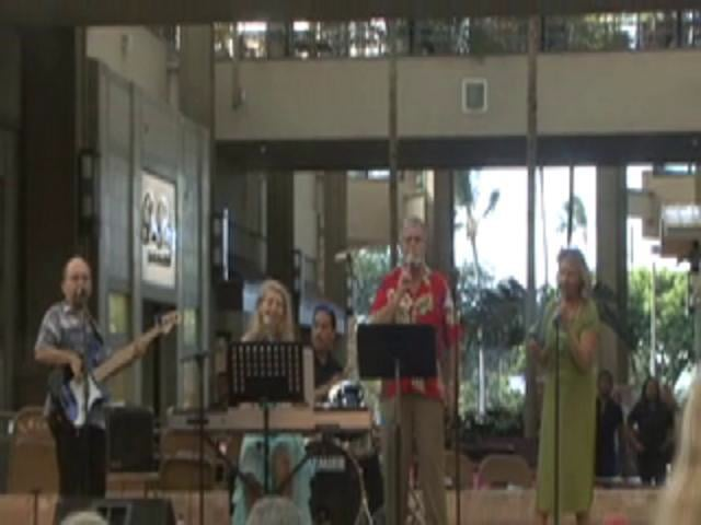Jason Schwartz sings with friends at celebration of the Season of Peace and Non Violence