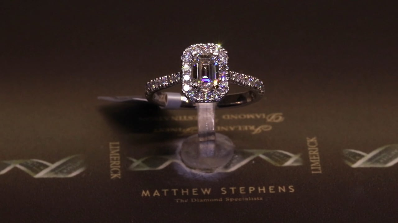 73205 - Emerald Halo with Diamond Shoulders, T1.10ct, Set in Platinum