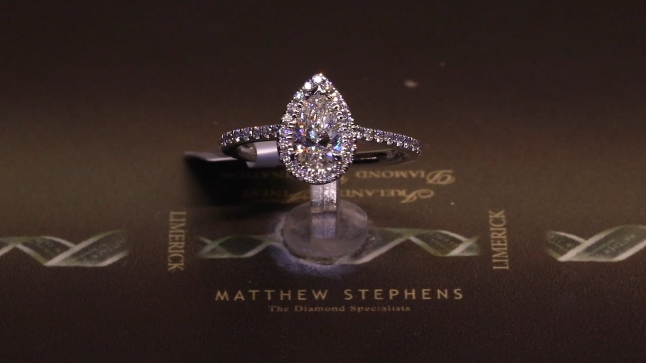 56835 - Pear Halo with Diamond Shoulders, Set in Platinum