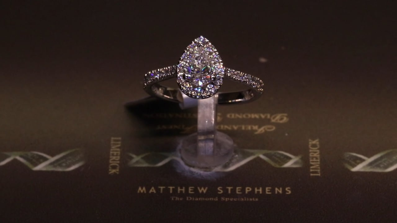 71483 - Pear Halo with Diamond Set Shoulders, T0.90ct, Set in Platinum
