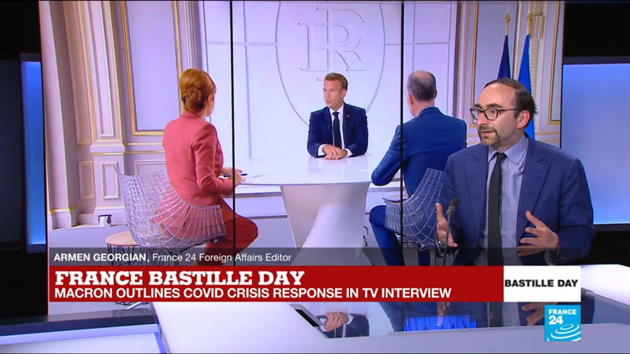 Macron announces COVID plans in Bastille Day interview